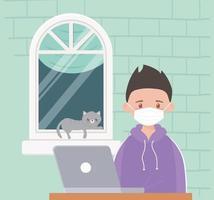 jongen op de laptop met kat op het raam