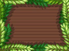 bovenaanzicht van leeg houten paneel met frame van bladerenelementen