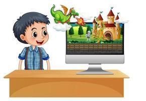 gelukkige jongen naast computer met kasteeltafereel op monitor