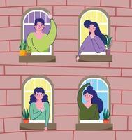 mensen kijken uit het raam in quarantaine