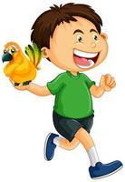 gelukkige jongen met papegaai