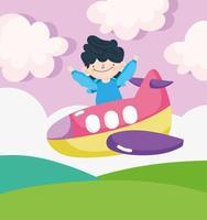 gelukkige kleine jongen in een vliegtuig met ballonnen