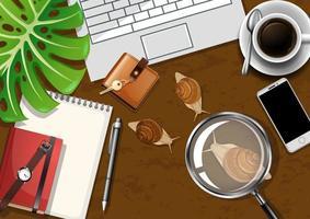 bovenaanzicht kantoor werktafel met kantoorelementen met groene bladeren