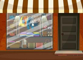 voorkant van kledingwinkel showcase met kleding en accessoires