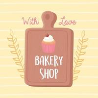 bakkerij winkel cupcake en snijplank embleem vector