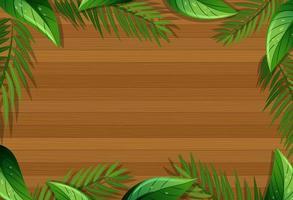 bovenaanzicht van lege houten tafel met bladeren elementen