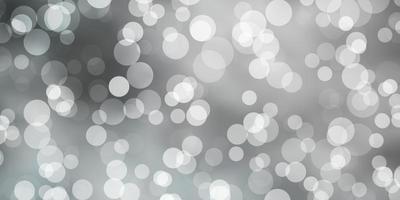 lichtgrijze achtergrond met bubbels. vector