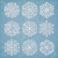 sneeuwvlokken op blauwe achtergrond vector