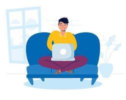 man met behulp van de laptop thuis