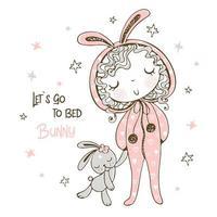 schattig meisje in pyjama met haar konijnenspeelgoed