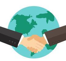 zakenlieden handen schudden over de aarde