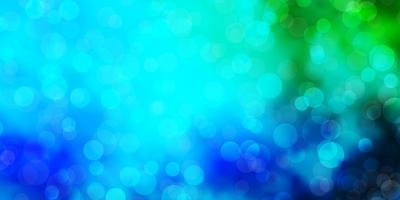 lichtblauwe, groene vectorachtergrond met cirkels. vector