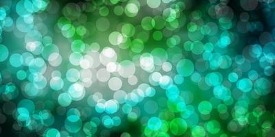lichtblauwe, groene vectorachtergrond met bellen. vector
