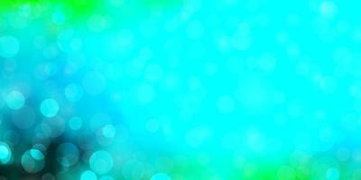 lichtblauwe, groene vectorachtergrond met cirkels.