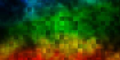 donkere veelkleurige vectorachtergrond in veelhoekige stijl.