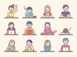 studenten zitten aan een bureau in de klas.