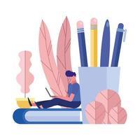 jonge man met laptop gezeten door boek en potlood houder