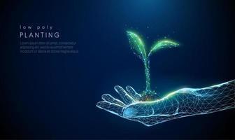 abstract hand geven met jonge plant in aarde.