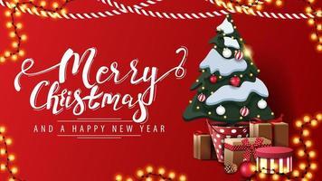 prettige kerstdagen en een gelukkig nieuwjaar, rode ansichtkaart in minimalistisch design met slingers en kerstboom in een pot met geschenken bij de muur vector