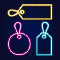 set neon prijskaartjes met verschillende kleuren en vormen. set van gloeiende realistische neon prijskaartjes van verschillende kleuren geïsoleerd op blauwe achtergrond. vector
