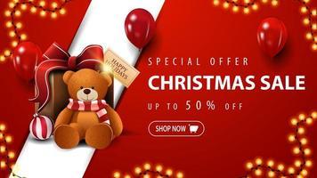 speciale aanbieding, kerstuitverkoop, tot 50 korting, rode kortingsbanner met slinger, rode ballonnen en cadeau met teddybeer vector