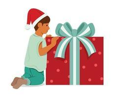 jongen met een grote doos met cadeautjes.