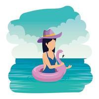 mooie vrouw met vlaamse vlotter die in de zee zwemt
