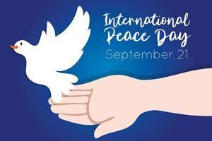 internationale dag van vrede belettering met hand en duif