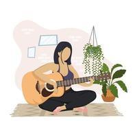 jonge vrouw gitaarspelen in het huis