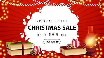 speciale aanbieding, kerstuitverkoop, tot 50 korting, mooie rode kortingsbanner met antieke lamp, kerstboeken, kerstbal en kegel