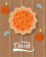 gelukkige diwali-viering met twee kaarsen en voedsel op houten achtergrond vector