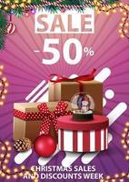 kerstverkoop en kortingsweek, tot 50 korting, roze verticale kortingsjabloon voor uw bedrijf met kerstcadeaus vector