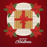 vrolijk kerstfeest belettering met cadeau en bladeren vector