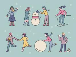 mensen die buiten spelen op een besneeuwde dag. vector
