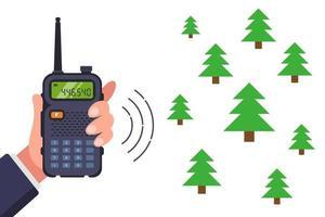 navigeren door het bos met een walkietalkie. platte vectorillustratie. vector