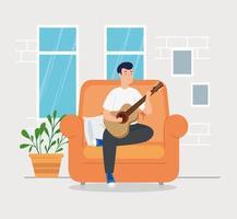 campagne thuis blijven met man in de woonkamer gitaar spelen