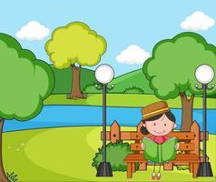 park scène met een meisje leesboek zittend op de bank