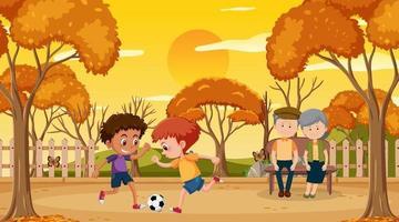 park bij zonsondergang tijdscène met voetballende kinderen