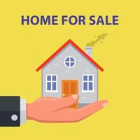 een man houdt een huis in zijn handpalm. onroerend goed te koop. platte vectorillustratie. vector