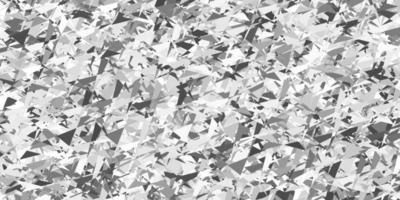 lichtgrijze vectorachtergrond met veelhoekige vormen.