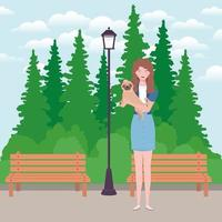 jonge vrouw die schattige hond in het park opheft vector