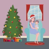 moeder en baby met de kerstviering van de pijnboom