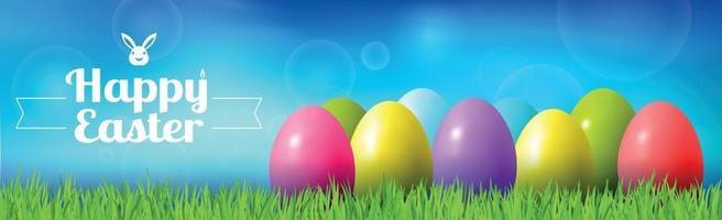 abstracte Pasen bokeh achtergrond met kleurrijke eieren liggend op het gras tegen de achtergrond van de hemel, gefeliciteerd met Pasen - illustratie
