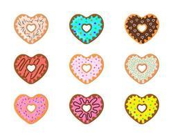 set van hartvormige donuts geïsoleerd op een witte achtergrond. verschillende zoete donuts voor Valentijnsdag vector