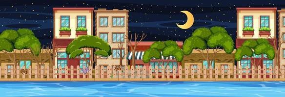 veel gebouwen langs de rivier horizontale scène 's nachts