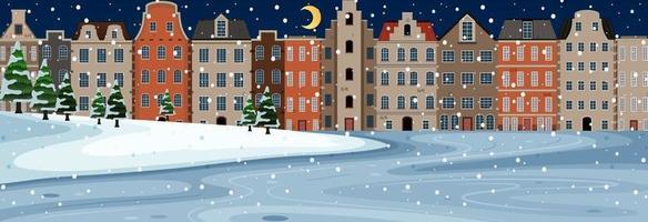 sneeuw vallende horizontale scène 's nachts met gebouwen in de voorsteden achtergrond