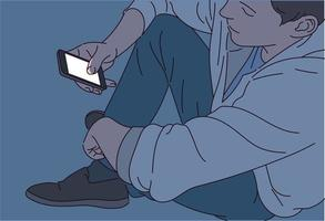 een man kijkt in het donker naar zijn telefoon en het licht op het scherm schijnt. vector