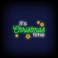 het is kersttijd neonreclames stijl tekst vector