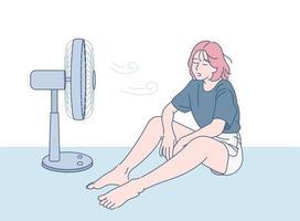 een meisje zit voor een ventilator om af te koelen. hand getrokken stijl vector ontwerp illustraties.