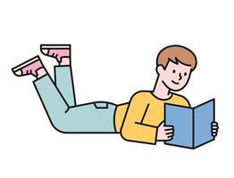 een jongen leest een boek dat op zijn buik op de grond ligt. platte ontwerpstijl minimale vectorillustratie.